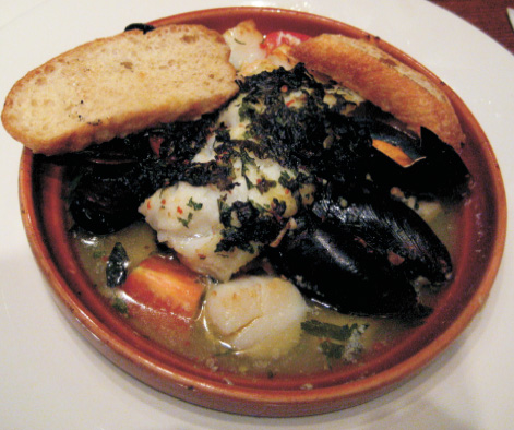 Scallops / Mussel Is bake with white wine with a herb bread crust in the shell